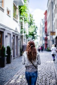 Woman walking through town.
