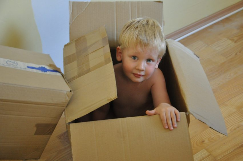 young child in box