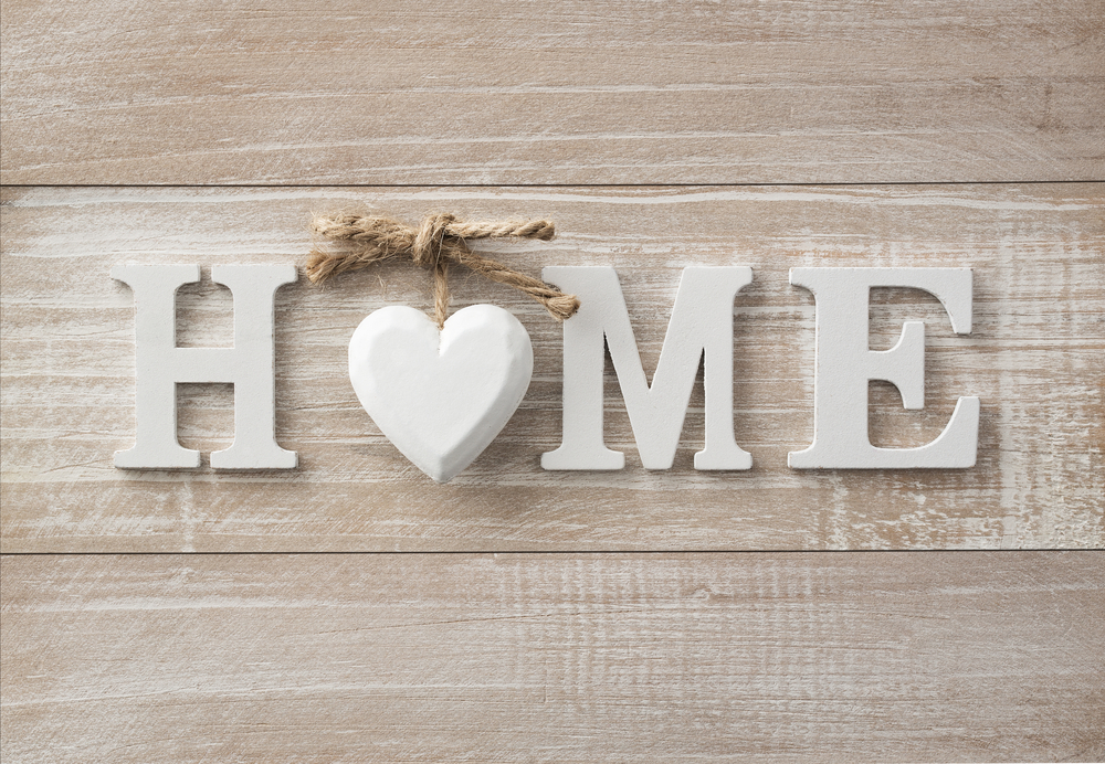 sign that says home with a heart for the o
