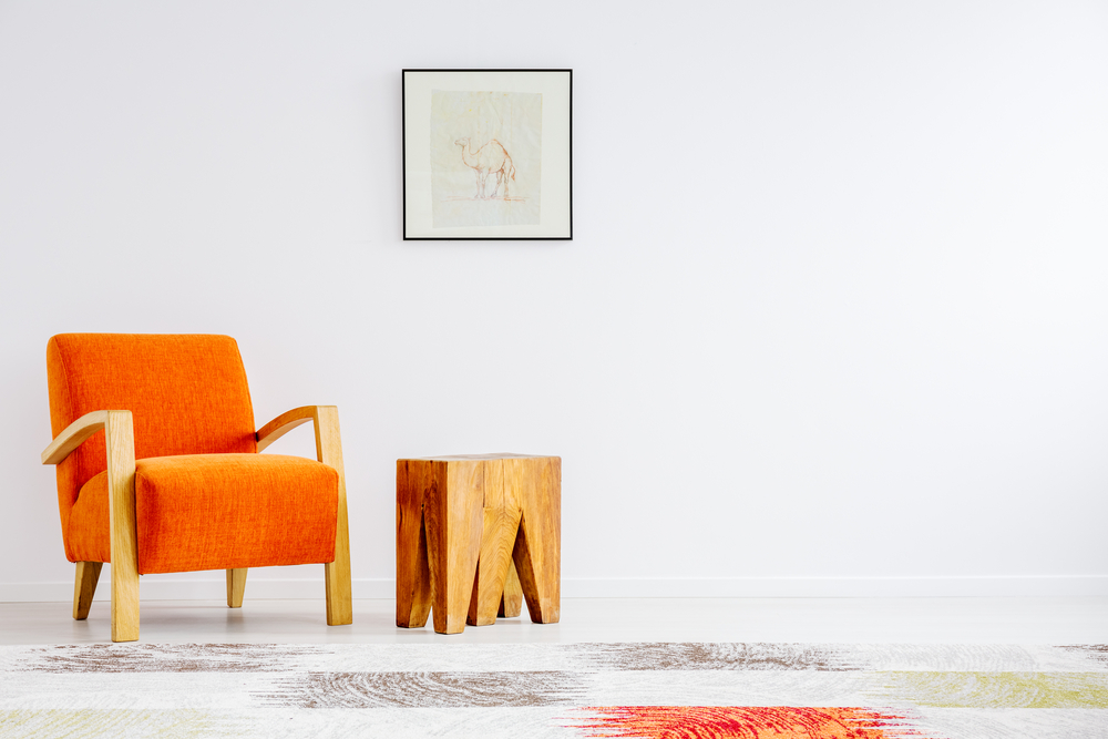 Orange chair to discuss when combining spaces